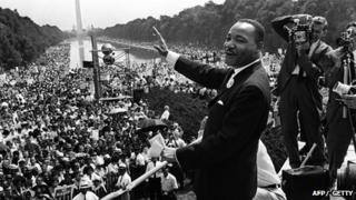 Martin Luther King waves to supporters 28 August 1963 on the Mall in Washington, DC