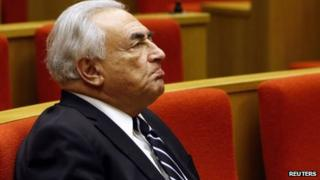 Former International Monetary Fund (IMF) chief Dominique Strauss-Kahn reacts as he attends a French Senate commission inquiry on the role of banks in tax evasion in Paris in this June 26, 2013 file picture.