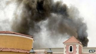 Smoke rises from the Villaggio Mall in Doha's west end, after a fire broke out inside the shopping centre on 28 May 2012, Qatar