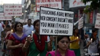 Indian activists holds placards as they protest against violence and crimes against women