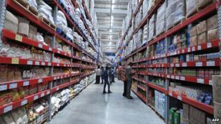 Shoppers browse through the products of a newly opened Bharti Wal-Mart Best Price Modern wholesale store in India