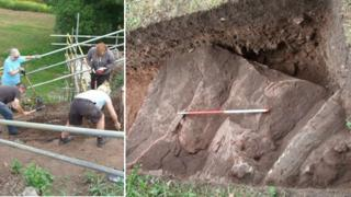 Volunteer archaeologists dig at Holt Castle; one of the foundation stones