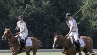 Prince William and Prince Harry playing polo.
