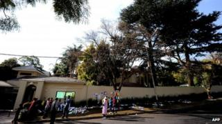 Well-wishers gather outside Nelson Mandela's home on 8 July 2013