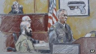 Maj Nidal Hasan and other court figures in a courtroom sketch from Tuesday 6 August 2013