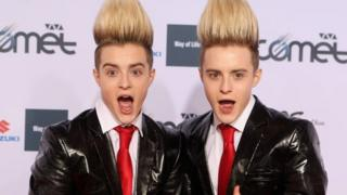 Jedward in black suits and a red tie