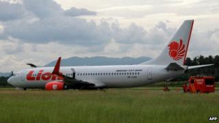 The Indonesian Lion Air passenger jet on a runway at Gorontalo airport on northern Sulawesi island (7 Aug 2013)