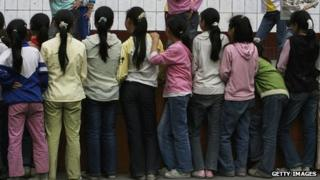 File photo: 'Left-behind' school children in Chongqing, China, 26 May 2006