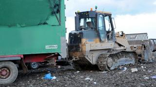 Lorry and digger at Milton landfill site, Cambridgeshire