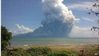 Photo taken from the Maurole district of East Nusa Tenggara province with a camera phone shows Mount Rokatenda volcano spewing a huge column of hot ash during an eruption on 10 August