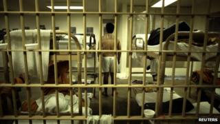An inmate stands in his cell at the Orange County jail in Santa Ana, California, 21 May 2011