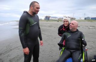 French swimmer Philippe Croizon with friends before attempting to cross the Bering Strait between the US and Russia in August 2012