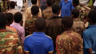 Children aged between 14 and 17 who were fighting in armed groups in CAR pictured in Bangui; about 21 of them were released following intervention from Unicef in May 2013
