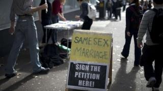 A signboard urging support of gay marriage attracts passersby in downtown Sydney