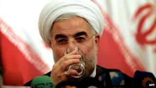 Iranian president-elect Hassan Rouhani drinks a glass of water during a press conference in Tehran on 17 June, 2013.
