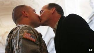 US Army Captain Michael Potoczniak (L) and Todd Saunders (R), partner of ten years exchange kisses during their wedding ceremony at City Hall in San Francisco 29 June 2013