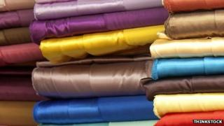 Stack of colourful fabric (stockshot)