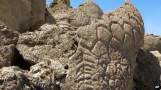 This May 2012 photo provided by the US Geological Survey shows ancient carvings on limestone boulders in northern Nevada's high desert near Pyramid Lake