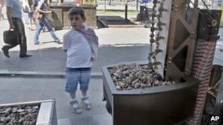 A boy looks at a show-window of Roshen sweet manufacturer shop in Kiev, Ukraine