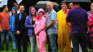 People in onesies outside the church
