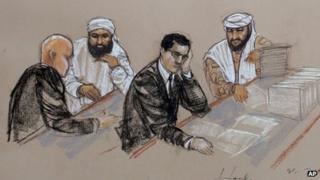 In this pool photo of a sketch by courtroom artist Janet Hamlin and reviewed by the US Department of Defense, accused 11 September co-conspirators Ammar al Baluchi, center left, and Ramzi Binalshibh, right, confer with their lawyers during pretrial hearings at the Guantanamo 19 August 2013