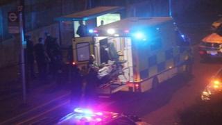Shot man put into ambulance