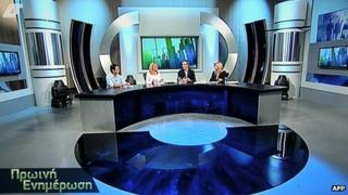 A TV screen shot shows Greece's new state television channel airing its firs news programme, on 21 August, 2013.