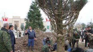 Tajik President Emomali Rakhmon oversees a tree planting ceremony in Dushanbe