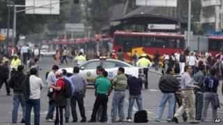 Teachers block Reforma Avenue, near Senate chambers, in Mexico City, Tuesday, Aug 20