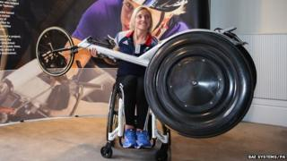 Shelly Woods holds up a revolutionary new racing wheel