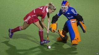 Netherlands Joyce Sombroek, defends against England's Georgie Twigg during a tie-break penalty shootout.