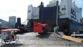 Rickshaw boarding a container ship