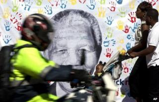 A banner of Nelson Mandela hangs outside his hospital in Pretoria, 19 July