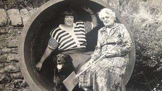 Mitzi Hayhurst and Annie Haythornthwaite sat in a boiler used in the festival 1800s