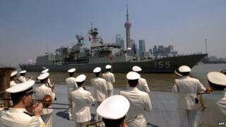 A Chinese navy band welcomes Australian frigate HMAS Ballarat as she arrives in Shanghai on 17 May 2012