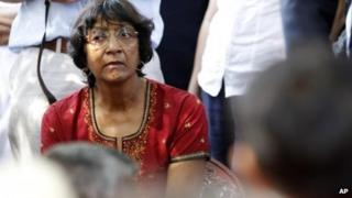 UN High Commissioner for Human Rights Navi Pillay listens to an ethnic Tamil war survivor during her visit to north Sri Lanka on 27 August 2013