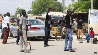 """Vigilantes from the """"Civilian Joint Task Force"""" group man a checkpoint in Maiduguri, Nigeria armed with with cutlasses and clubs on 7 August 2013 (file image)"""