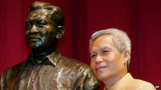 File photo of Sombath Somphone of Laos, shown with the bust of former Philippine President Ramon Magsaysay in Manila after he won the award for community leadership in 2005