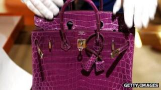 Purple crocodile skin handbag