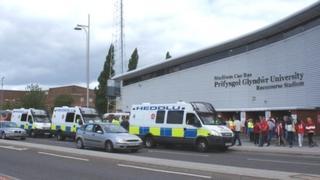 Police vans outside Racecourse stadium