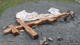 Felled wooden cross in the Altai mountains