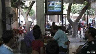 Egyptians watch television