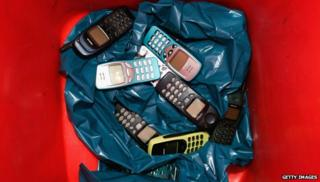 Nokia phones in a bin
