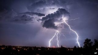 Lightning strikes from a cloud during a thunderstorm above the city of Goerlitz, eastern Germany, on 4 August 2013