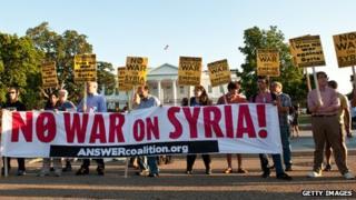 Anti-war protestors hold signs