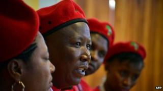Julius Malema (2nd L) gives a press conference during the launch of his new political party Economic Freedom Fighters (EFF) on July 27, 2013 in Soweto, outside Johannesburg.