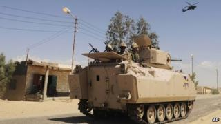 Egyptian Army soldiers patrol in an armoured vehicle ( file picture)