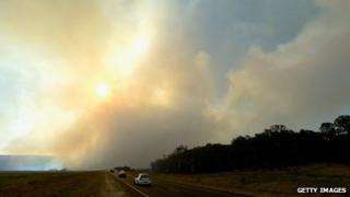 Smoke rises as fire crews battle grass fires in Castlereagh on 10 September 2013 in Sydney, Australia