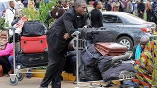 Travellers disrupted by the fire at Nairobi's international airport - August 2013