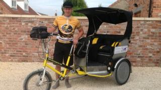 Luke Parry with his rickshaw